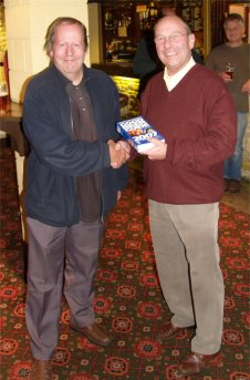 John Buckley of CAMRA presents Brian Hand of Longmeadow Sports and Social Centre with a copy of the Good Beer Guide 2007