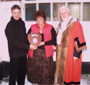 The Clacy's receive the trophy for best shop window display