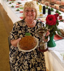 Brigitte Braod with her prize winning fruit cake and trophy for best in show rose