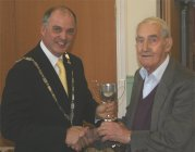 Ernie Bromley receives Vegetable Section Trophy