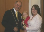 Jane Acott receives the Mayor's Trophy for the Harvest Home's display