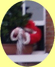 Blurred close up of Father Christmas tipping snow on the mayor